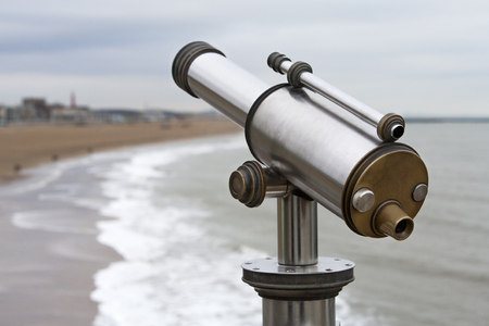 scheveningen: Telescope with the coastline at Scheveningen in the Netherlands in the background