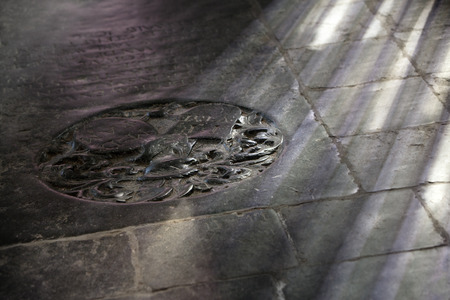 stone tombstone: Black worn ancient tombstone on the floor of a church in Dordrecht in the Netherlands Stock Photo