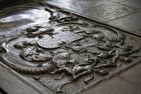 stone tombstone: Black worn tombstone on the floor of a church in Dordrecht in the Netherlands Stock Photo