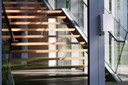 hardwood: Contemporary hardwood staircase behind a glass door Stock Photo