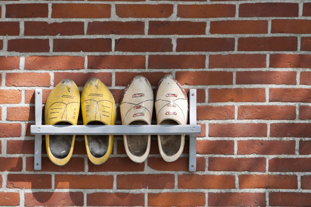 wooden shoes: Wooden shoes hanging outdoor on a wall Stock Photo