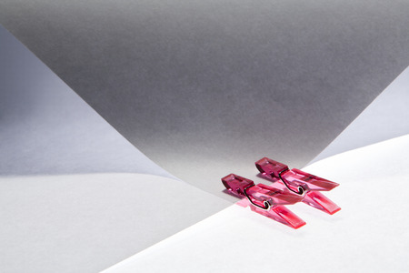 holding paper: Red clips holding paper together