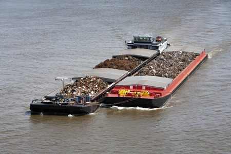scrap trade: Two barges loaded with metal scrap on the river