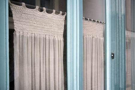 nostalgia: Nostalgia glass front door and partly knitted curtains Stock Photo