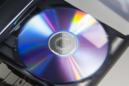 Ejecting disc from desktop computer, with motion blur
