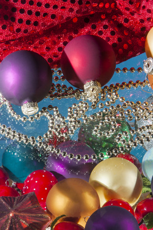 ball and chain: Colorful christmas balls decoration and bead chain with reflections