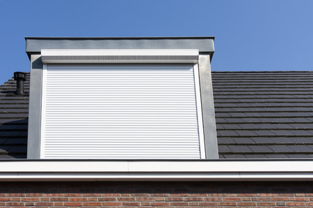 Dormer window with rolling safety  shutter in the Netherlands Archivio Fotografico