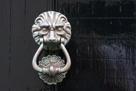 Antique Lion Door Knocker On A Black Wooden Door In The Netherlands Stock  Photo   65828609