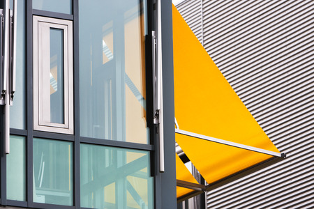 awnings: Closeup of a modern office building with yellow awnings