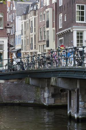 prinsengracht: Bicycles attached to a bridge on the Prinsengracht in Amsterdam Stock Photo
