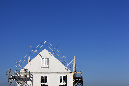 Construction site with houses with prefabricated walls in the Netherlands and a lot of blue sky Stock Photo