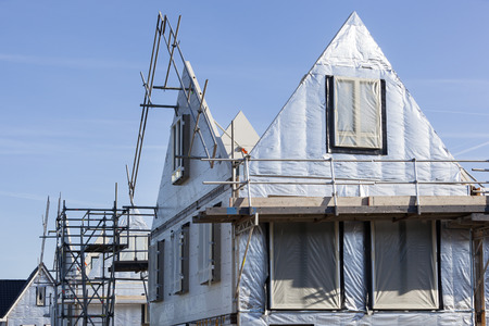 Construction site with houses with prefabricated walls in the Netherlands Stock Photo