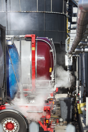 unloading: Tankers unloading raw milk for dairy factory in the Netherlands Stock Photo