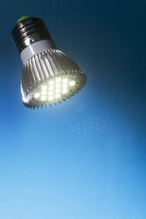 Energy saving  led light with blue background Stock Photo