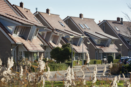 Houses in a residential district with dormers in the Netherlands Stock Photo