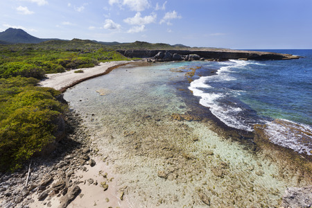 Coastline of Boka Grandi Christoffel National Park on Curacao with Mount Christoffel on the left side in the distance Stock Photo