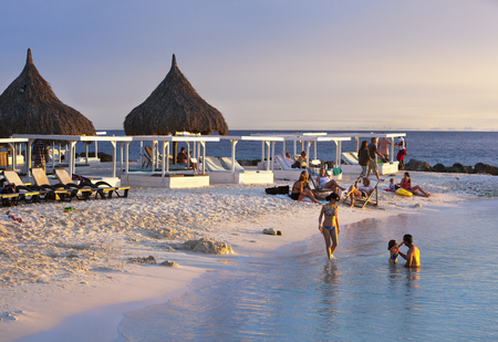 Lounge vacation on the Jan Thiel bay beach on Curacao during sunset