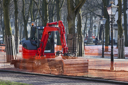 reconstructing: Excavator reconstructing the street in the center of the Hague in the Netherlands