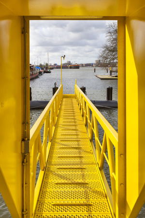 Yellow ship gangway in Rotterdam in the Netherlands