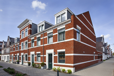 Street corner with new built classic style houses in Rotterdam in the Netherlands
