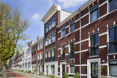 Street with new built classic style houses in Rotterdam in the Netherlands