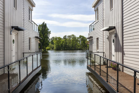 Houses built on piles in the water in the Netherlands Stock Photo