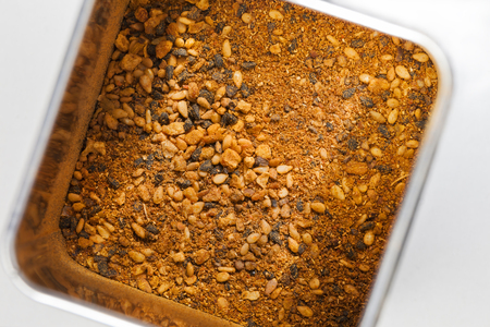 Shichimi togarashi spice mixture in a metal can seen from above Stock Photo