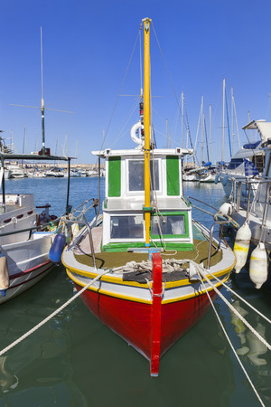 Colorful traditional fishing boats in Heraklion harbor on Crete in Greece