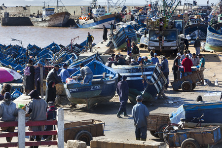 A lot of tourists and local people visiting the harbor of Essaouira Editorial