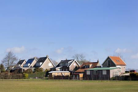 Dike houses in polder landscape in the Hoeksewaard in the Netherlands