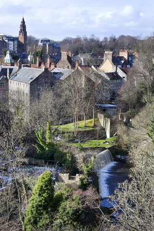 View on Dean village with waterfall on a sunny day in Edinburgh