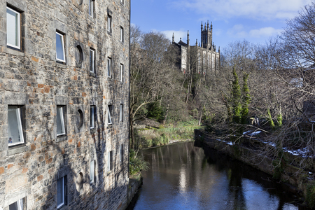 Dean village with apartments on the left side and the Rhema Christian Centre Church on Dean bridge in the background Stockfoto