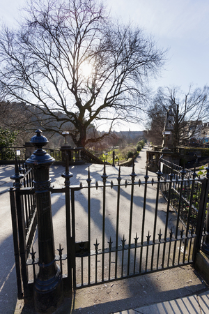 Fence and entrance to the princes street garden on a sunny day in Edinburgh