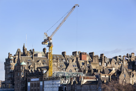View on the old town buildings and construction crane in Edinburgh