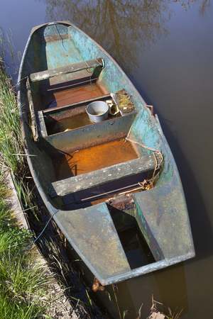 Old metal rusty rowing boat seen from above in the Netherlands Stockfoto