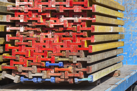 Colorful wooden beams for building market stalls stacked on a truck in the Netherlands