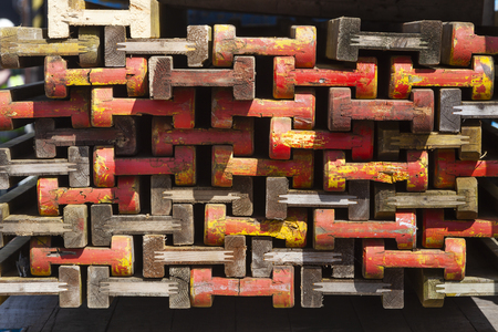 Stack of colorful wooden beams for building market stalls in the Netherlands Фото со стока