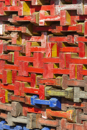 Stack of colorful wooden beams for building market stalls in the Netherlands Stockfoto