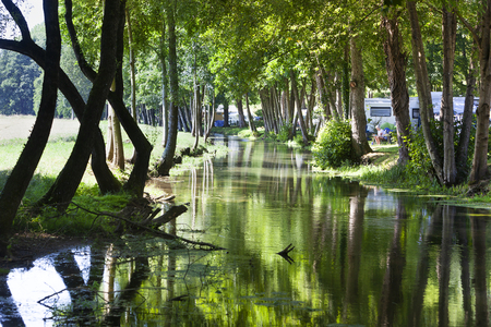 Camping site near foggy water in Louvemont in France Stockfoto