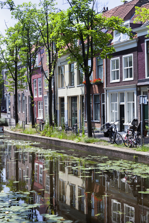 Canal and picturesque houses in Delft in the Netherlands