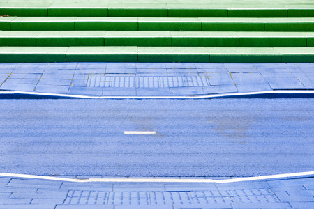 Blue painted bicycle path and green steps in Rotterdam in the Netherlands