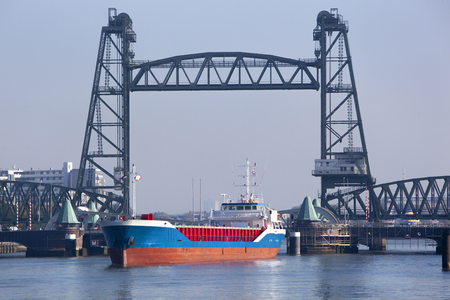 Monument and old railway bridge de Hef and ship in Rotterdam in the Netherlands