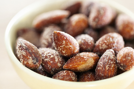 Close-up of salted almonds in a bowl