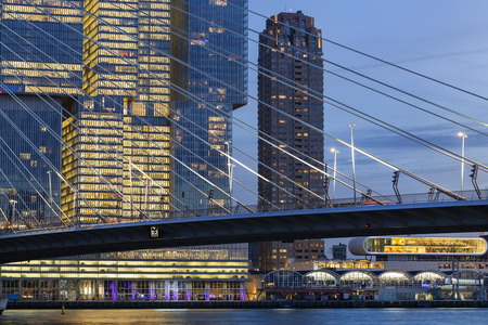 Cityscape at twilight with offices and apartments near the Erasmus bridge at the Kop van Zuid in Rotterdam