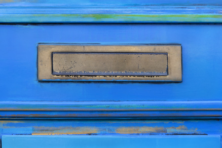 Letterbox on a vintage blue door in Schoonhoven in the Netherlands