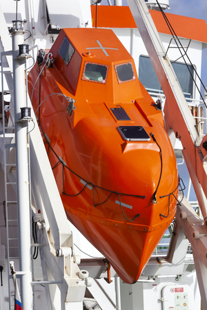 Modern orange lifeboat on a ship moored in Rotterdam in the Netherlands