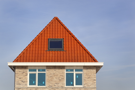 New built house with traditional red roof tiles in the Netherlands