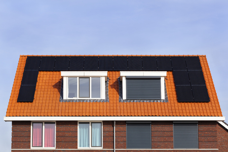 Neighbors with different lifestyles in the Netherlands. Contemporary rolling security shutters instead of curtains 스톡 콘텐츠