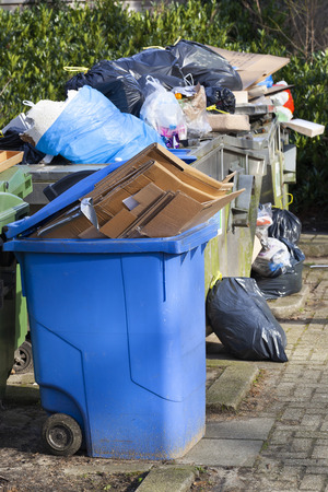 Overloaded garbage containers in a street in Capelle aan den IJssel in the Netherlands