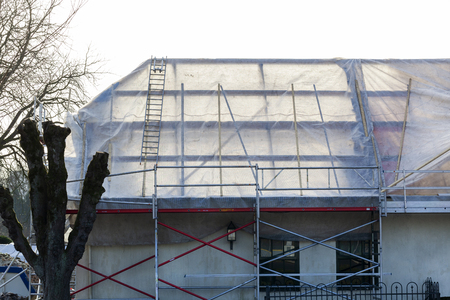 Roof covered with plastic sheeting because of a complete roof renovation in the Netherlands